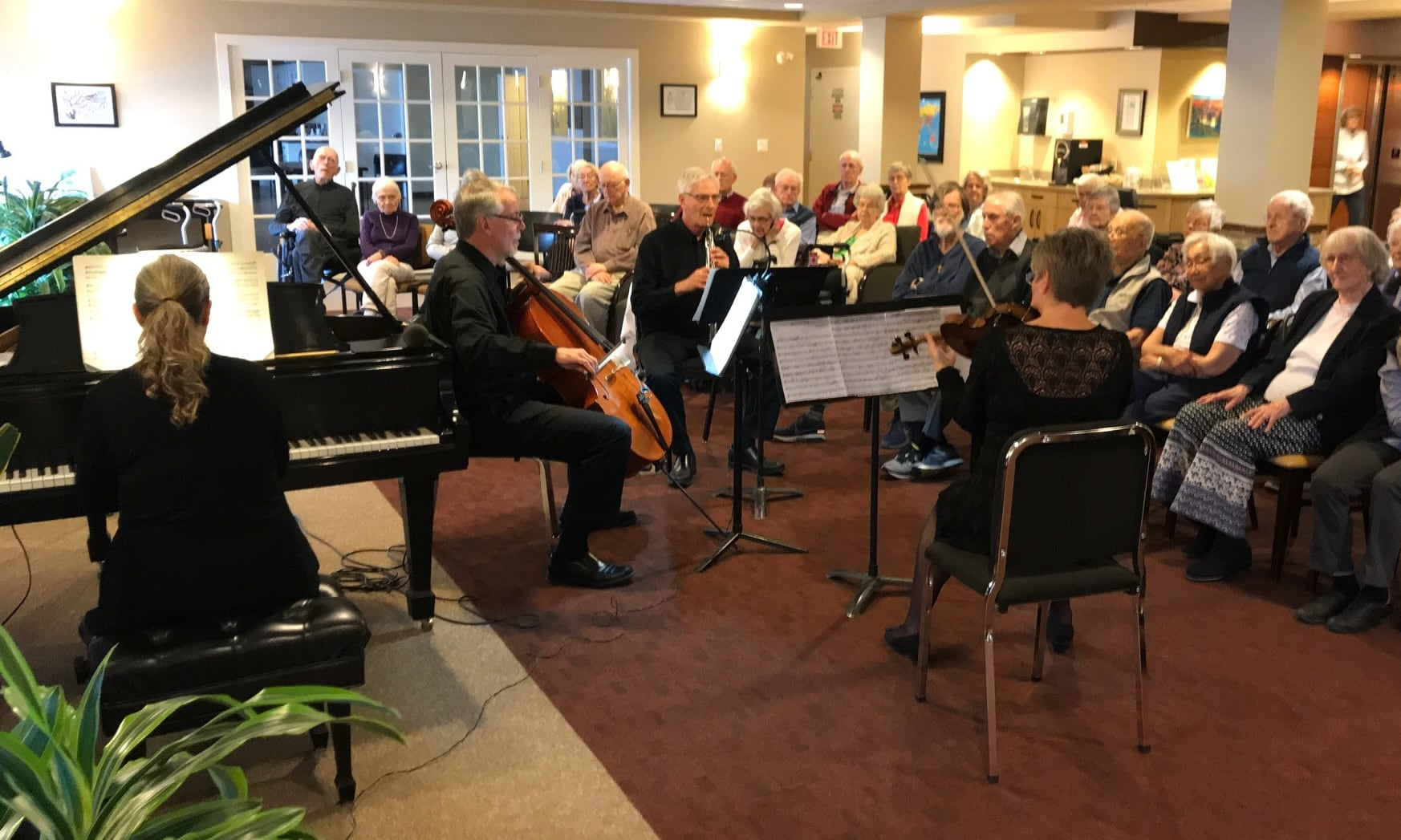 A CPO quartet performs for residents