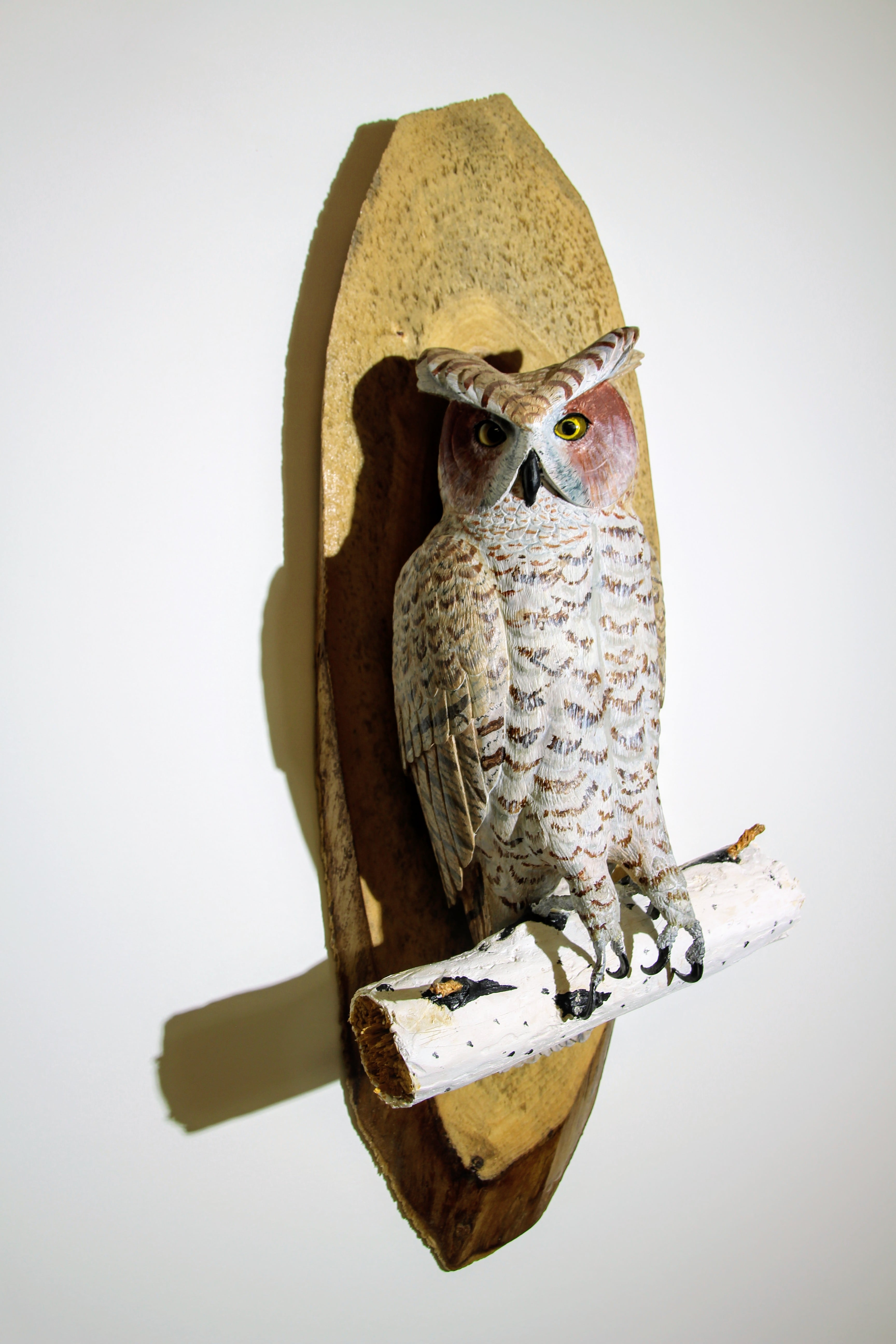 Resident Con Irving's owl carving hangs in the Fish Creek art gallery