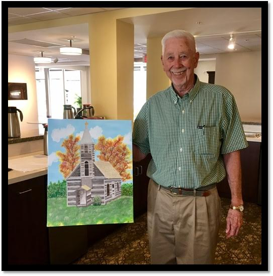 Conrad Irving proudly displays one of his paintings