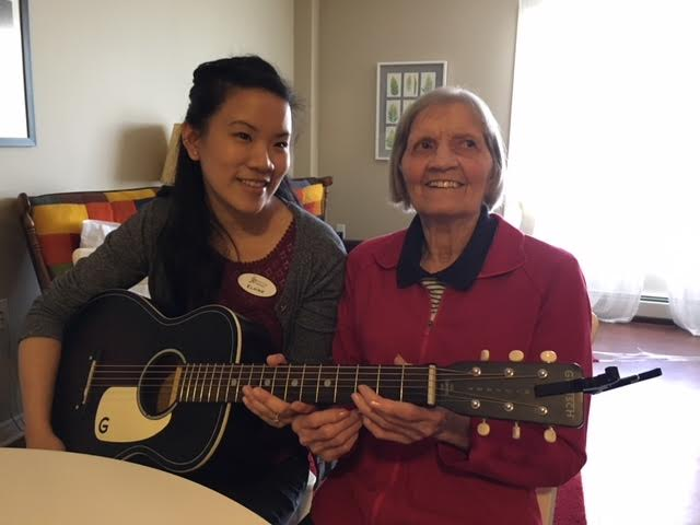 Elsie with her music therapist