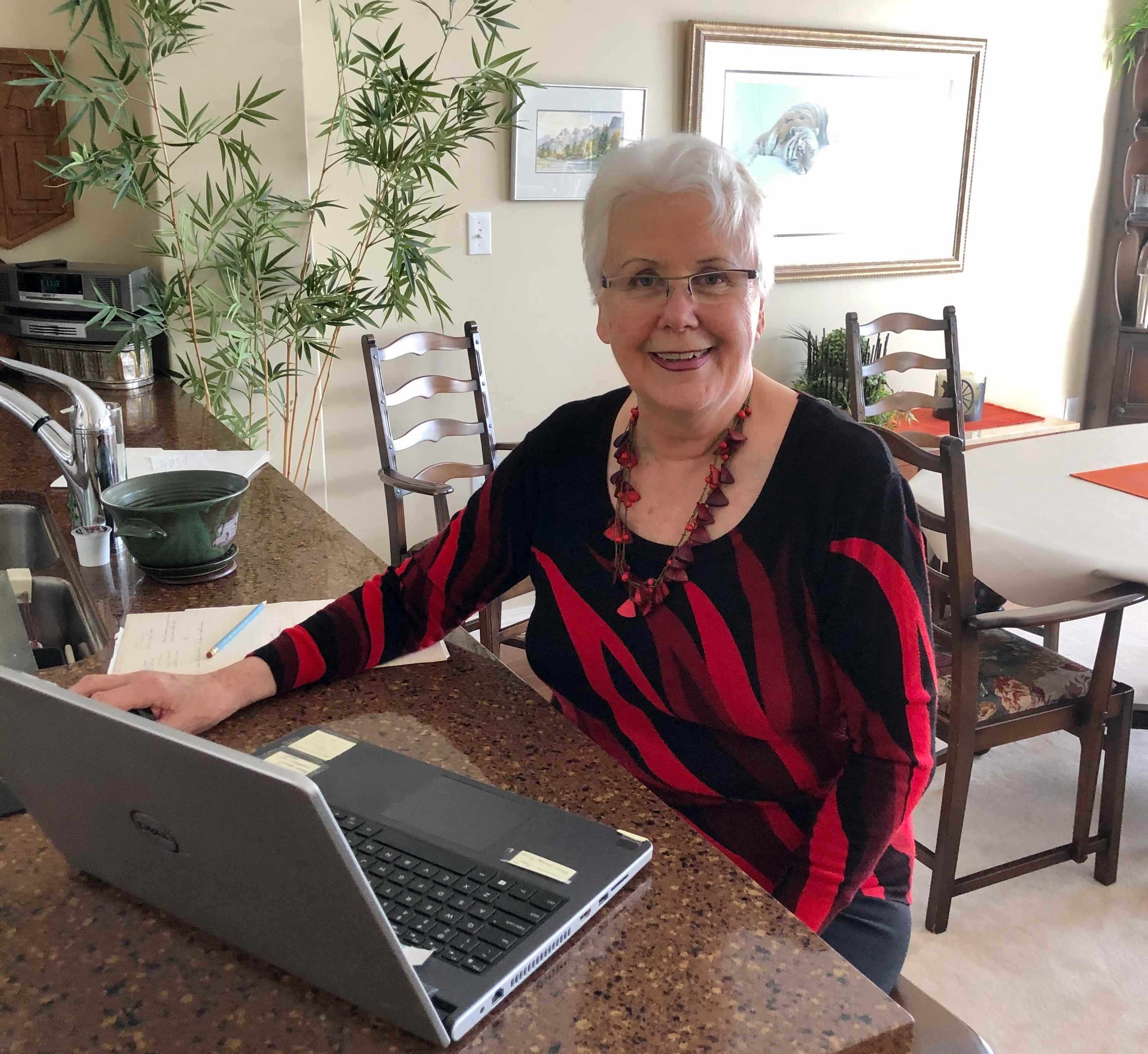 Fish Creek resident Libby Roth on her computer