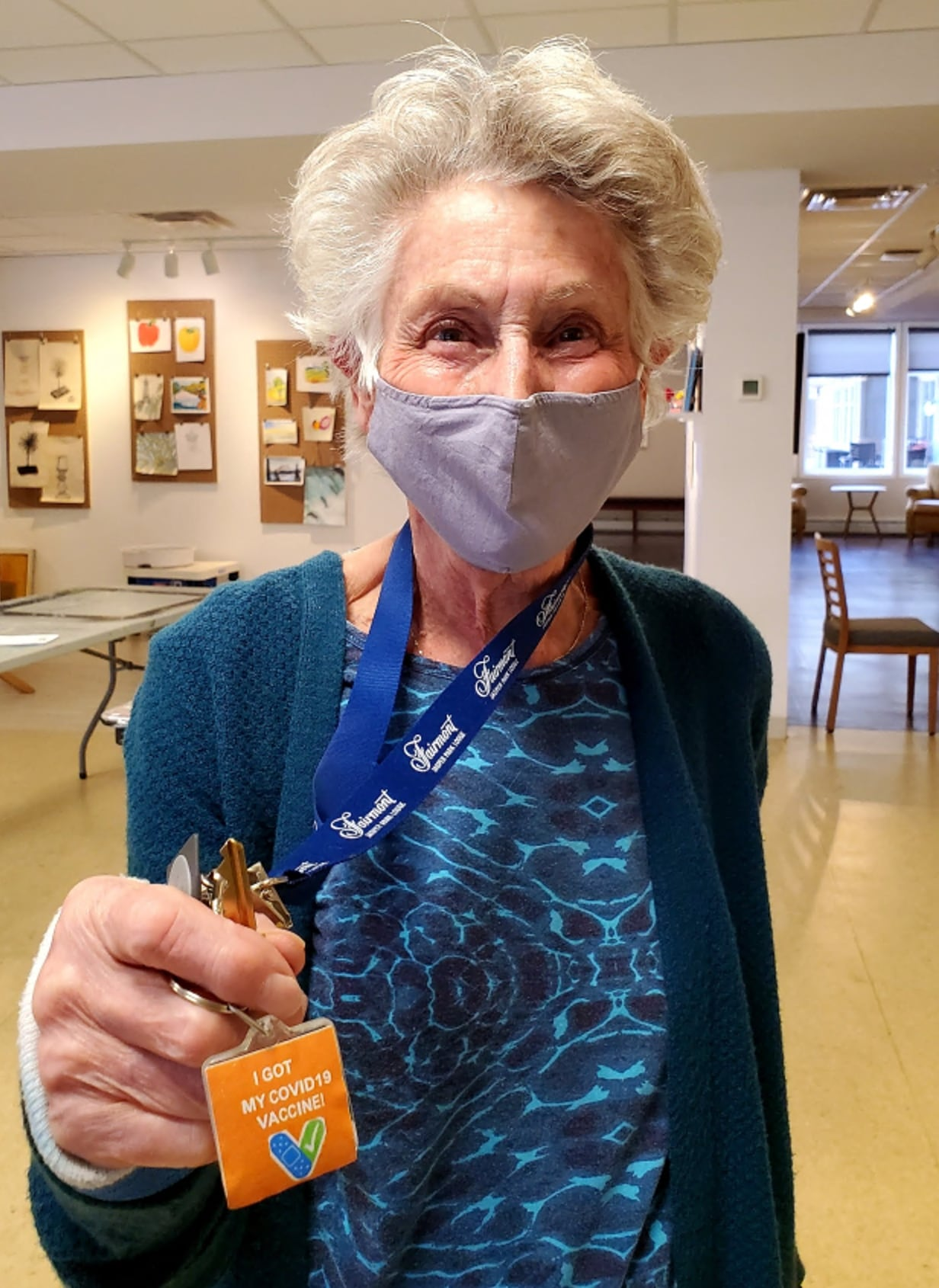 Fish Creek resident Maureen Miller shows off her vaccination sticker