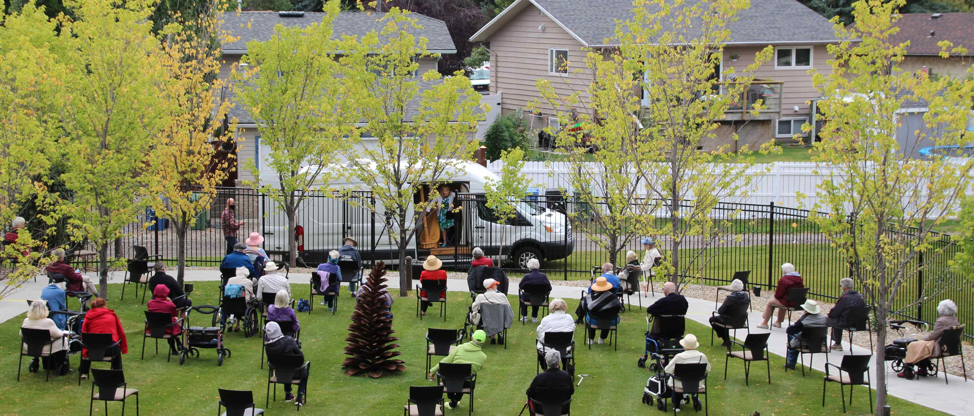 Fish Creek residents are treated to a travelling harp performance