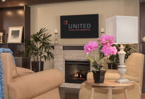A quiet sitting area around the fireplace in the Fish Creek community