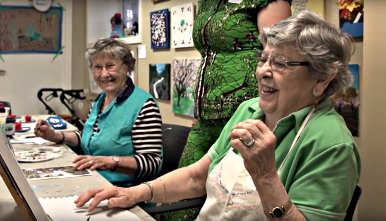Garrison Green residents Hertha Reich (left) and Betty Earle share a laugh in the art studio