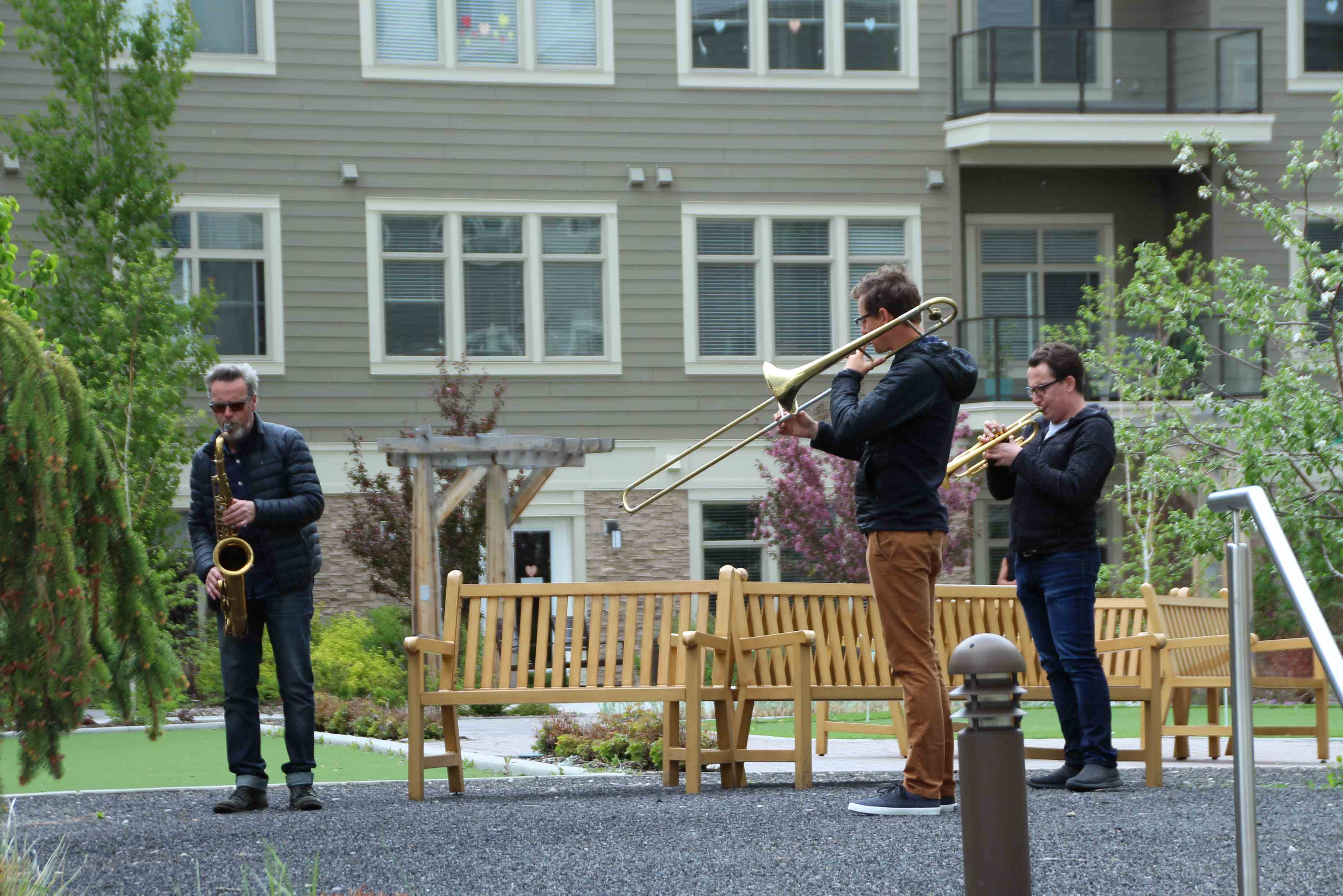 Mark DeJong (left) and friends perform jazz favourites for residents of Fish Creek