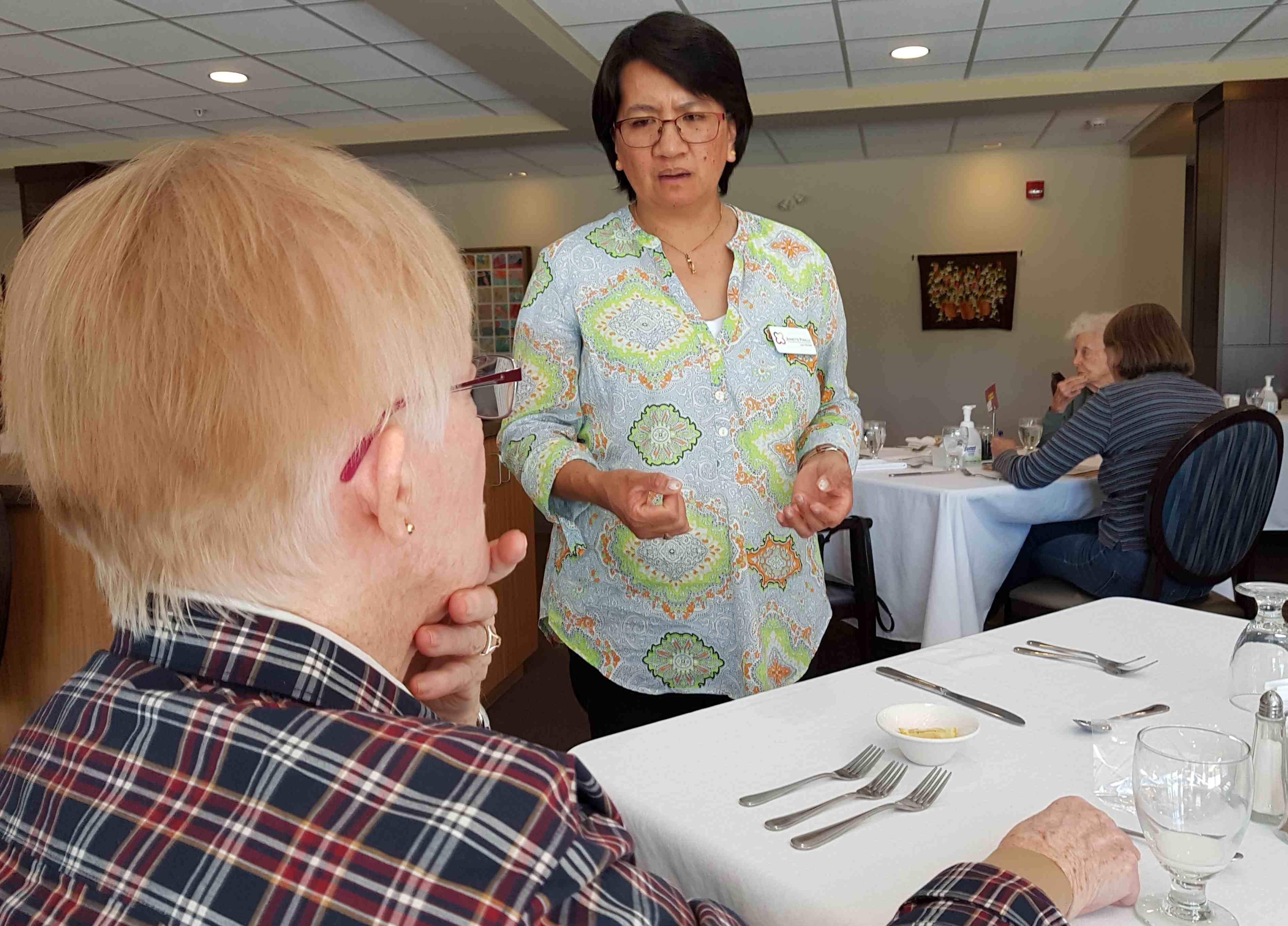 Jeanette Padilla discusses a special menu request from resident Diane Ness