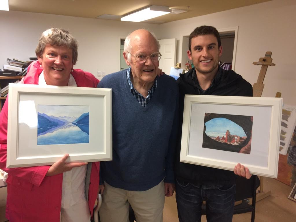 Jim Dolph, centre, with his daughter Laurie and his grandson showing off some of his artwork pre-COVID