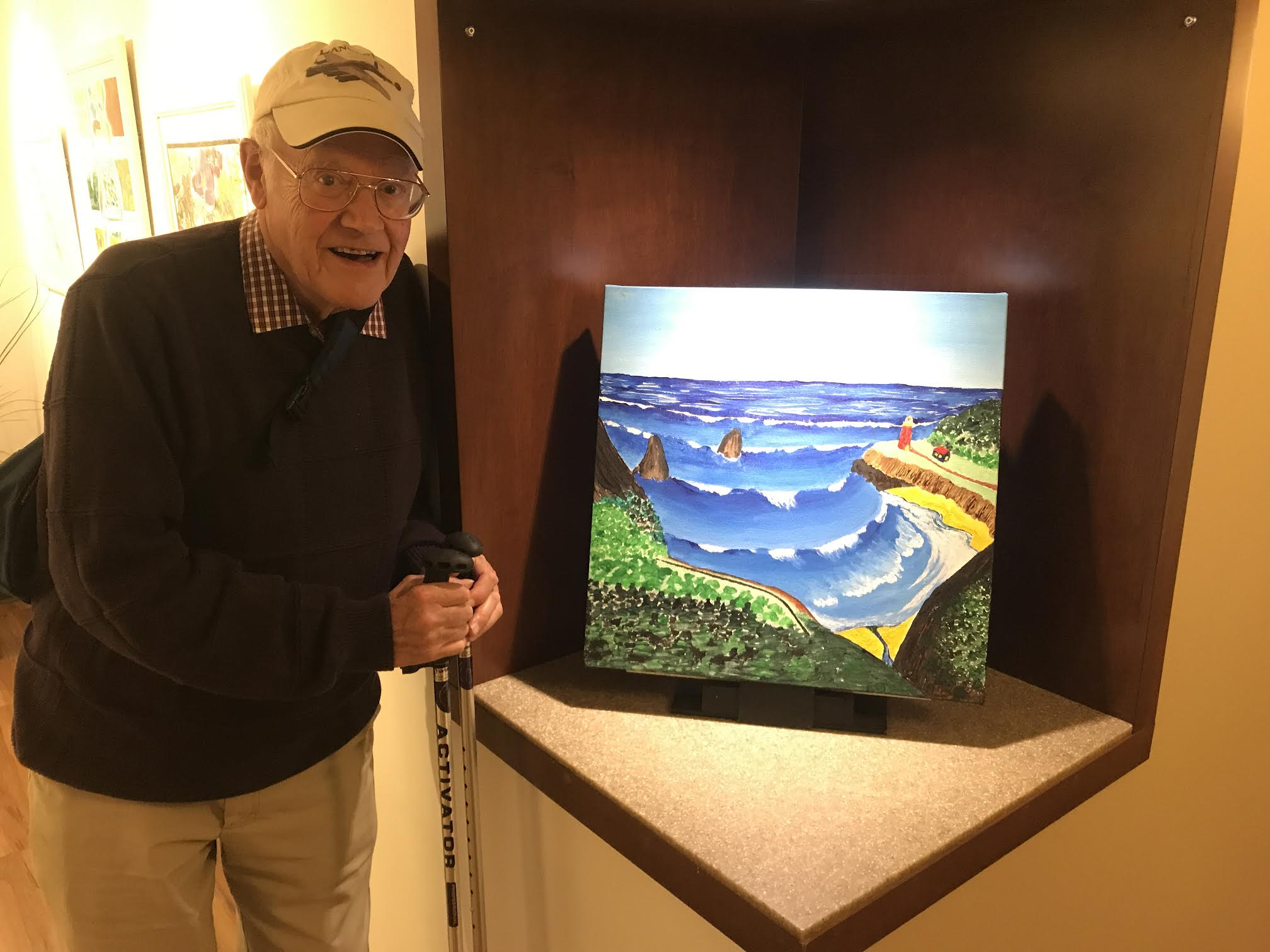 Resident Jim Dolph with an ocean painting