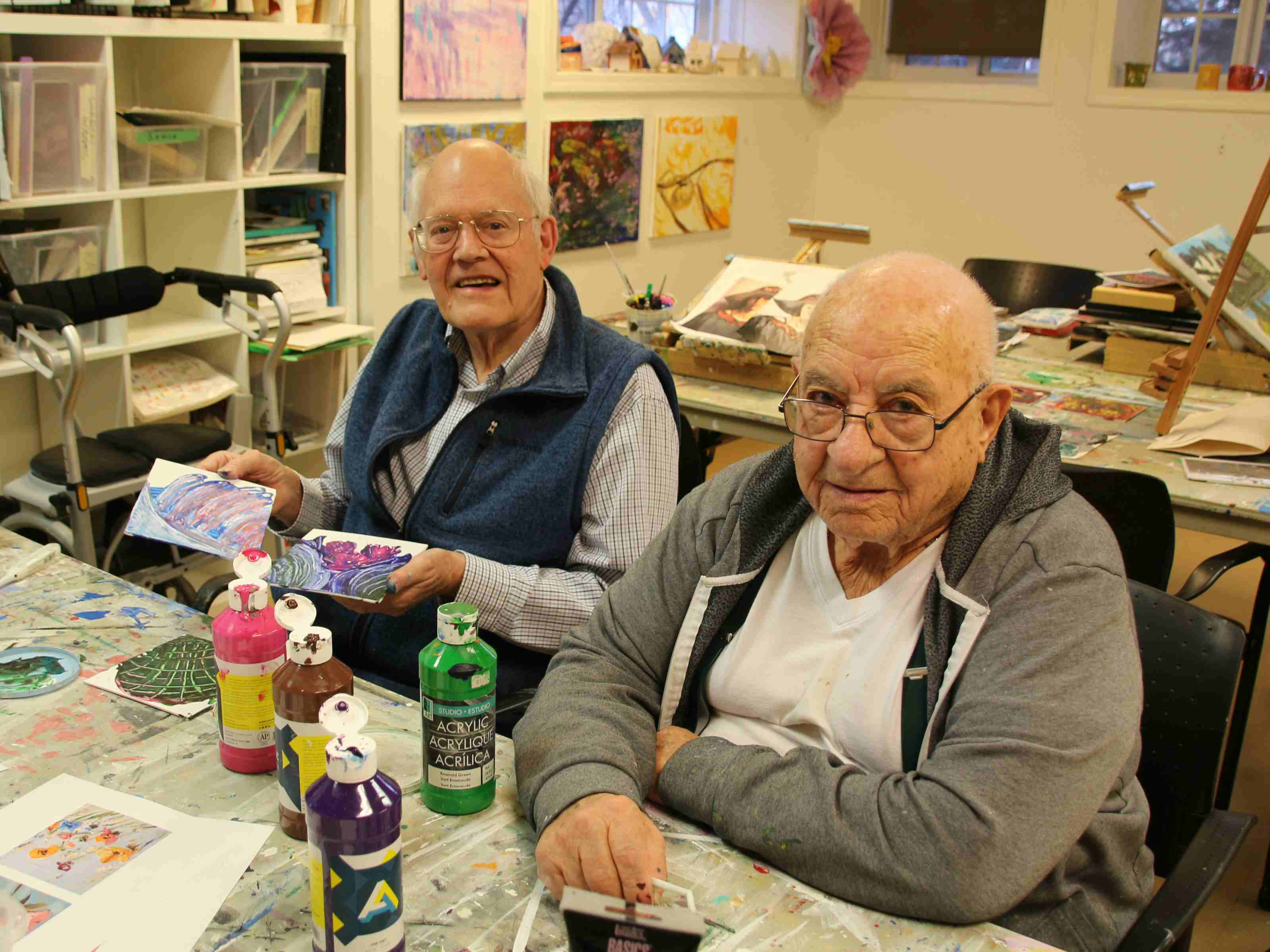 Council member Jim Dolph, left, with resident Carlo Romano in the Garrison Green art studio