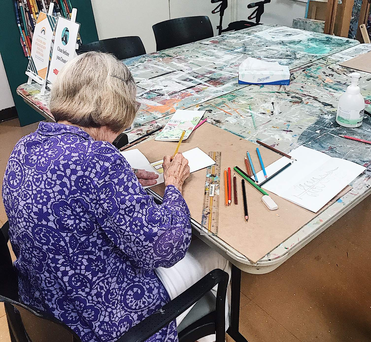Louise Dean concentrates on a project in the Garrison Green art studio