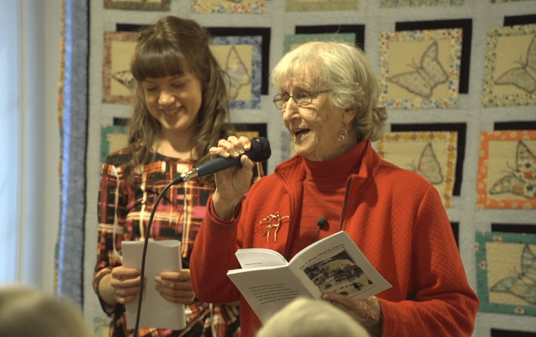 Mary Fenwick and Monica Schmidt reading a story