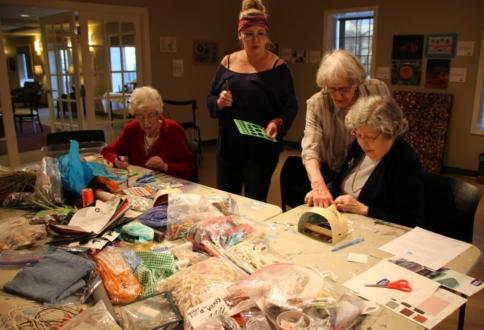 Garrison Green residents making masks in the art studio.