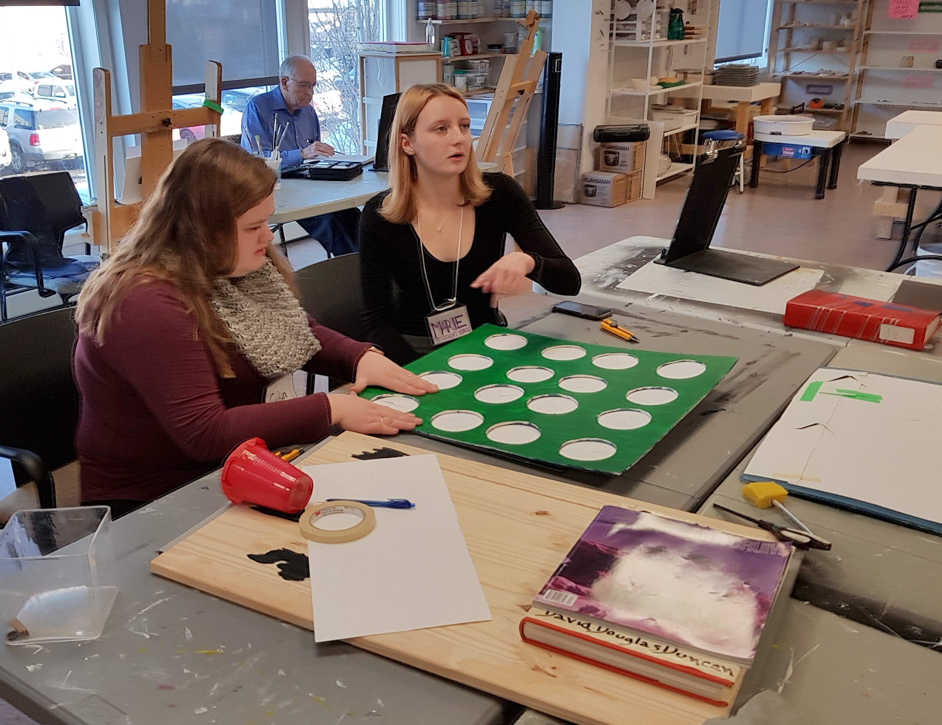 Nursing students prepare an art project for residents