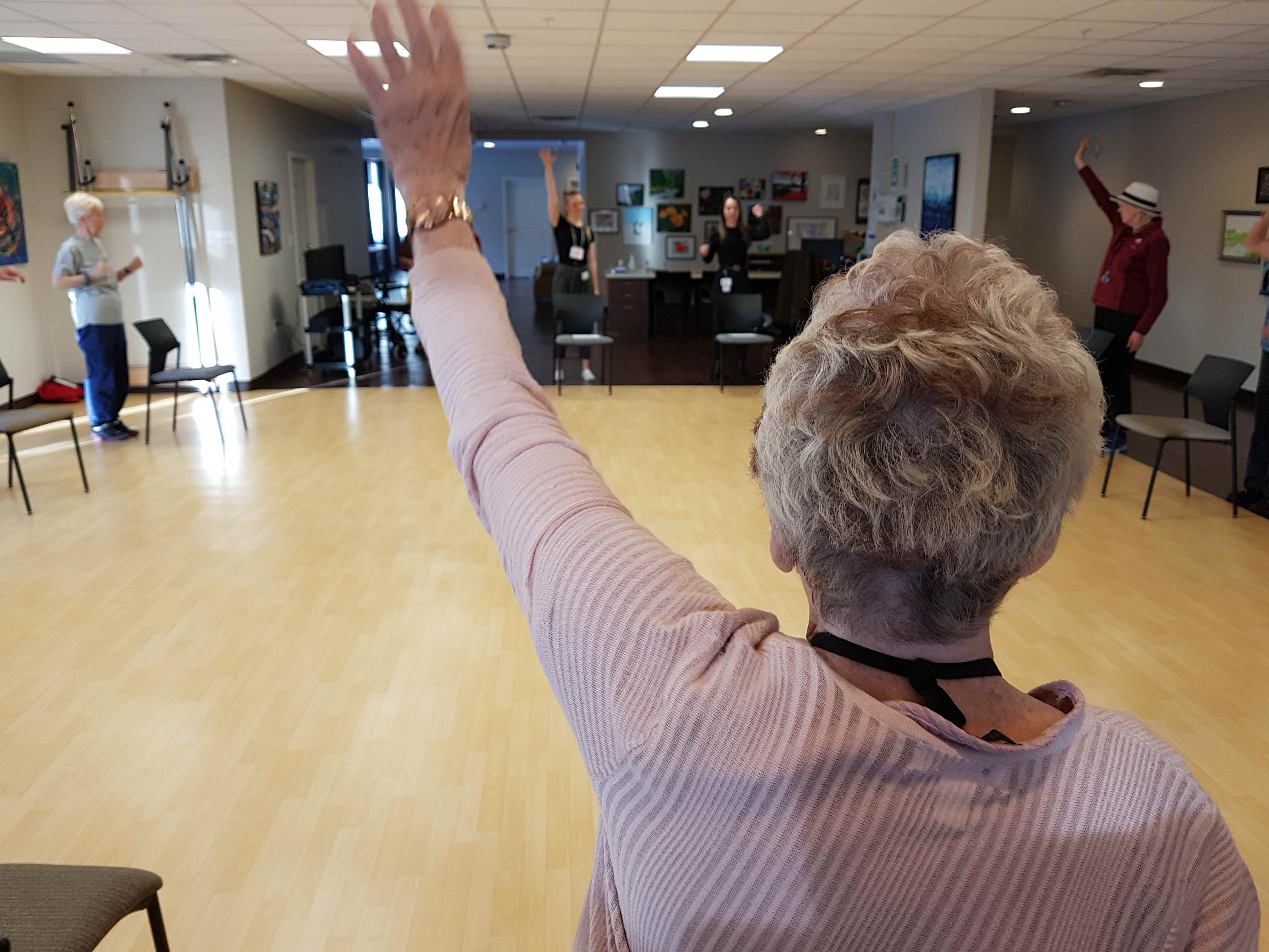 Nursing students guide residents through an exercise class
