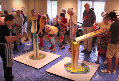 Garrison Green residents try their hand at pouring paint to create unique art forms