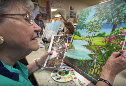 Garrison Green resident Hertha Reich enjoys painting in the art studio