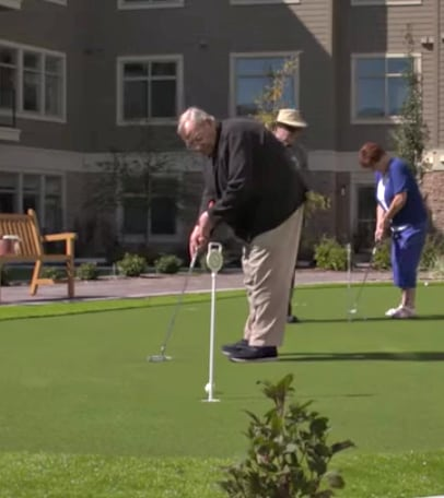 Ray Waldock on the putting green at United's Fish Creek community