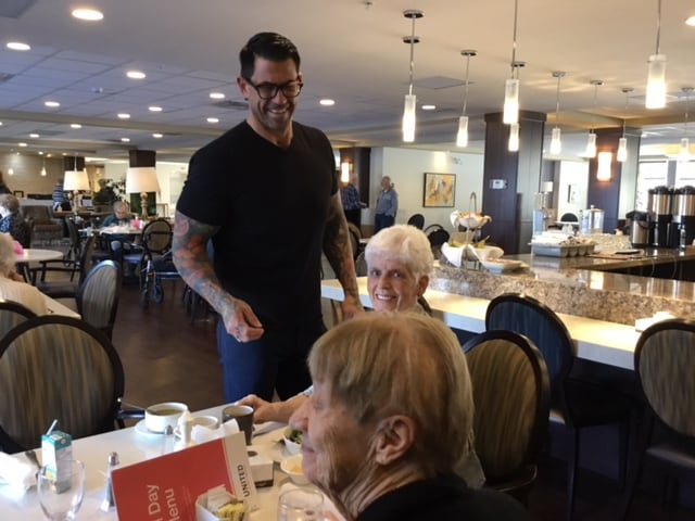 Food and beverage manager Ryan Bourquin shares a laugh with a resident