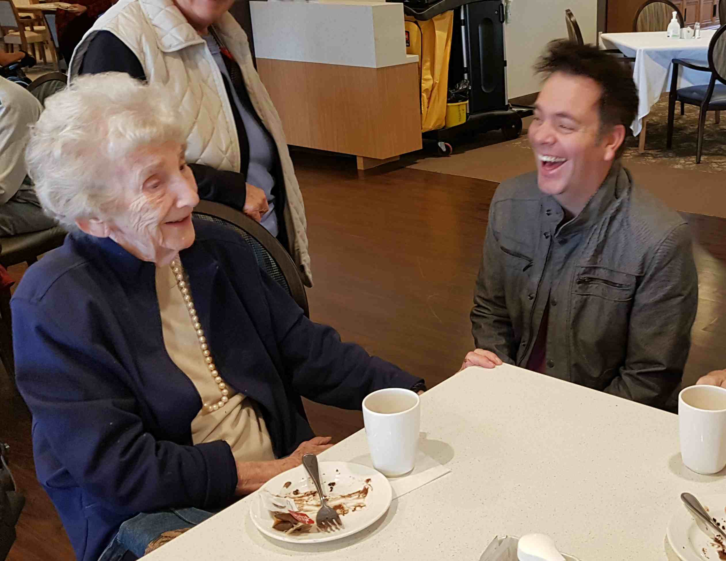 Johnny Summers shares a laugh with resident Margaret Hails