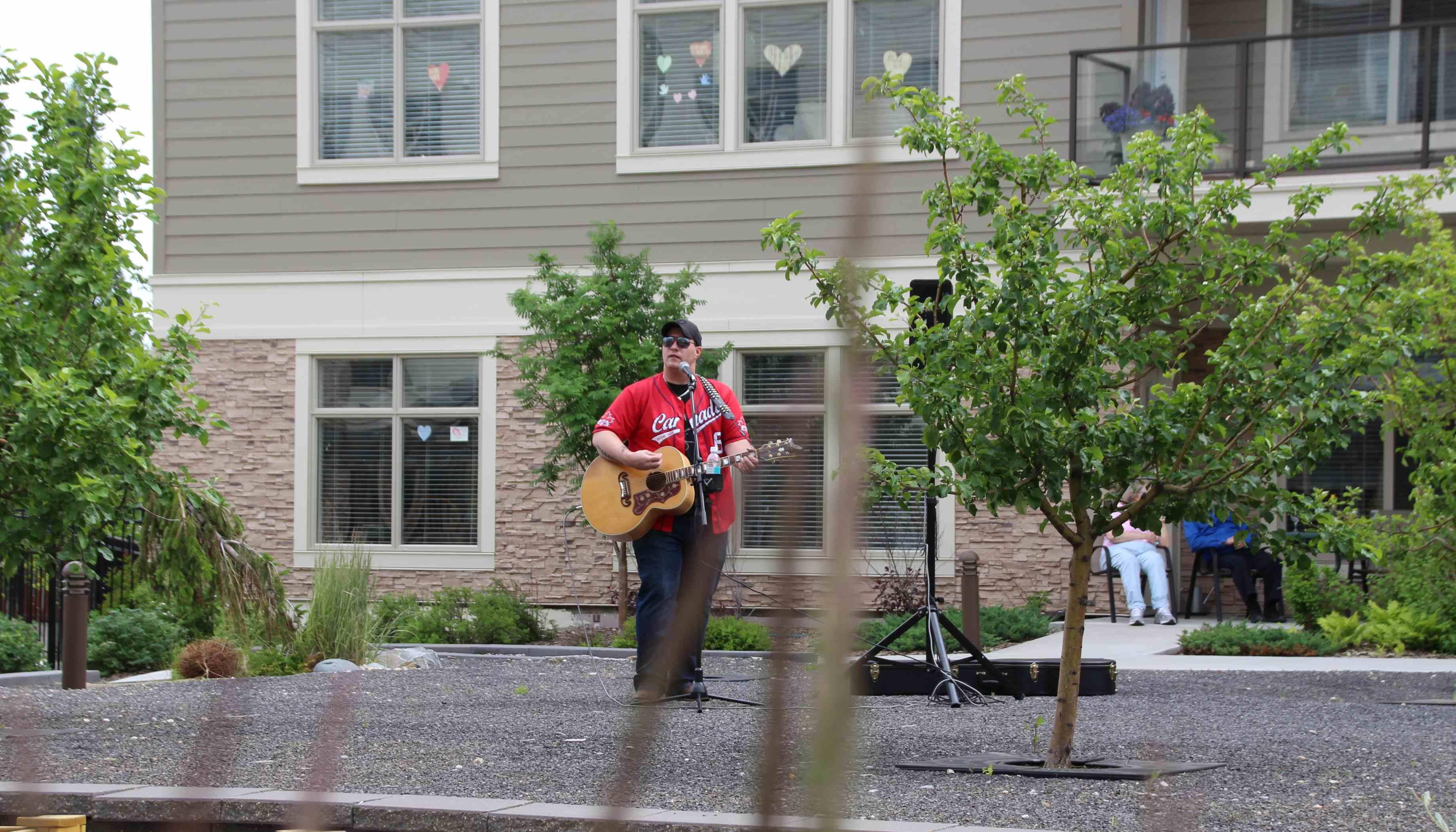 Singer Travis Pickering entertaining residents at United's Fish Creek community