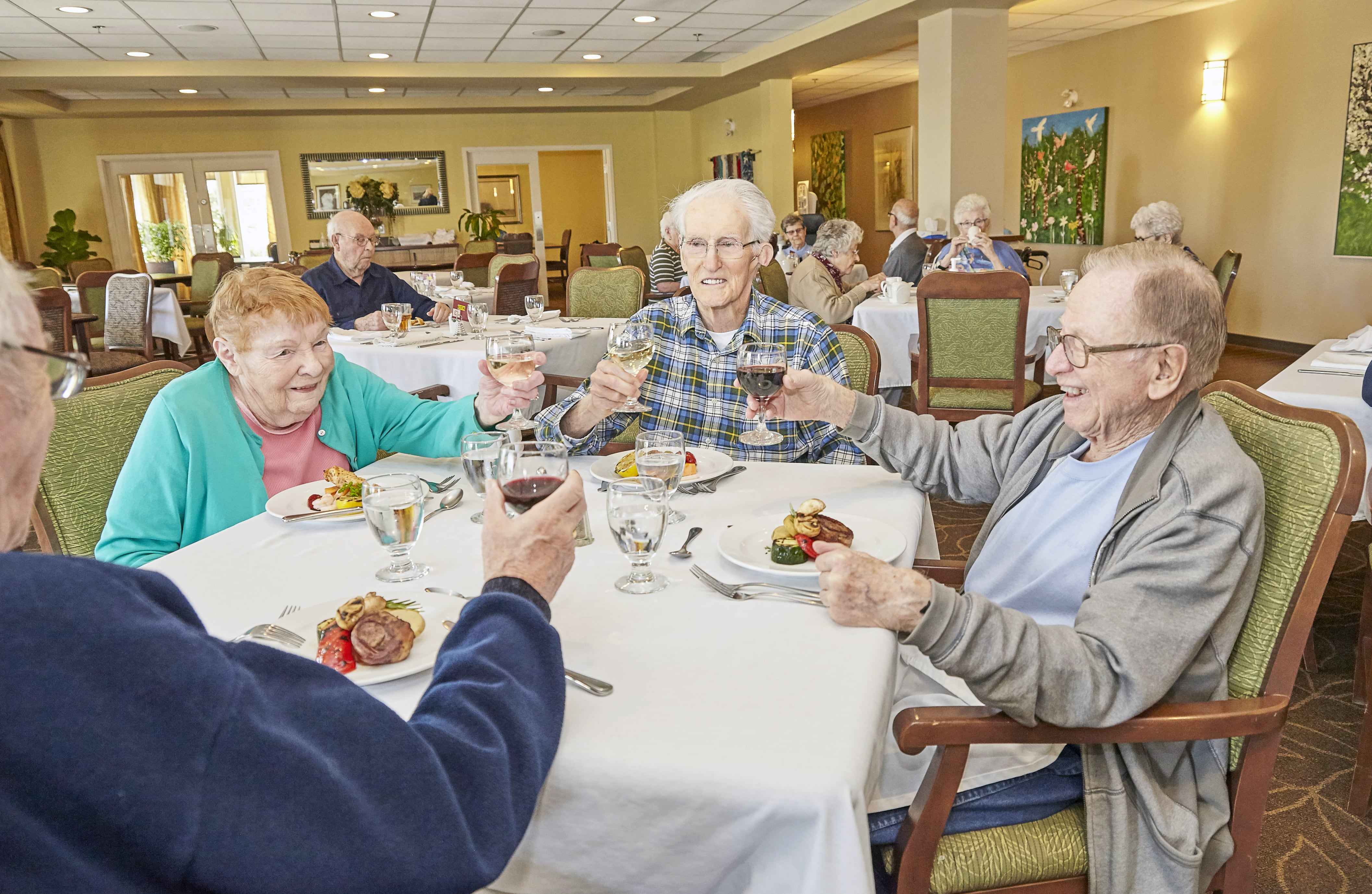 Residents enjoying a meal in the Garrison Green dining room