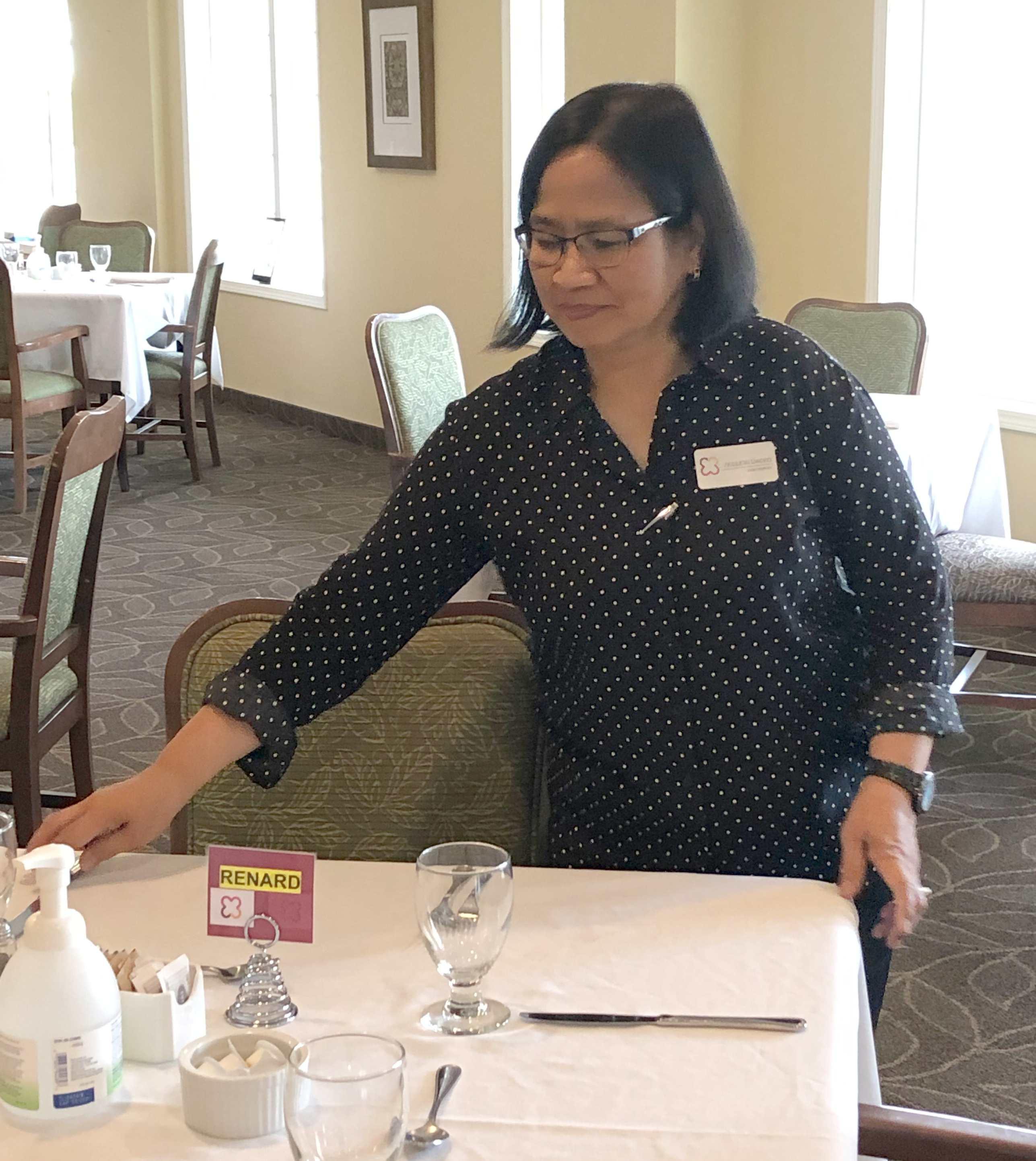 Violeta Cacho sets a table for four