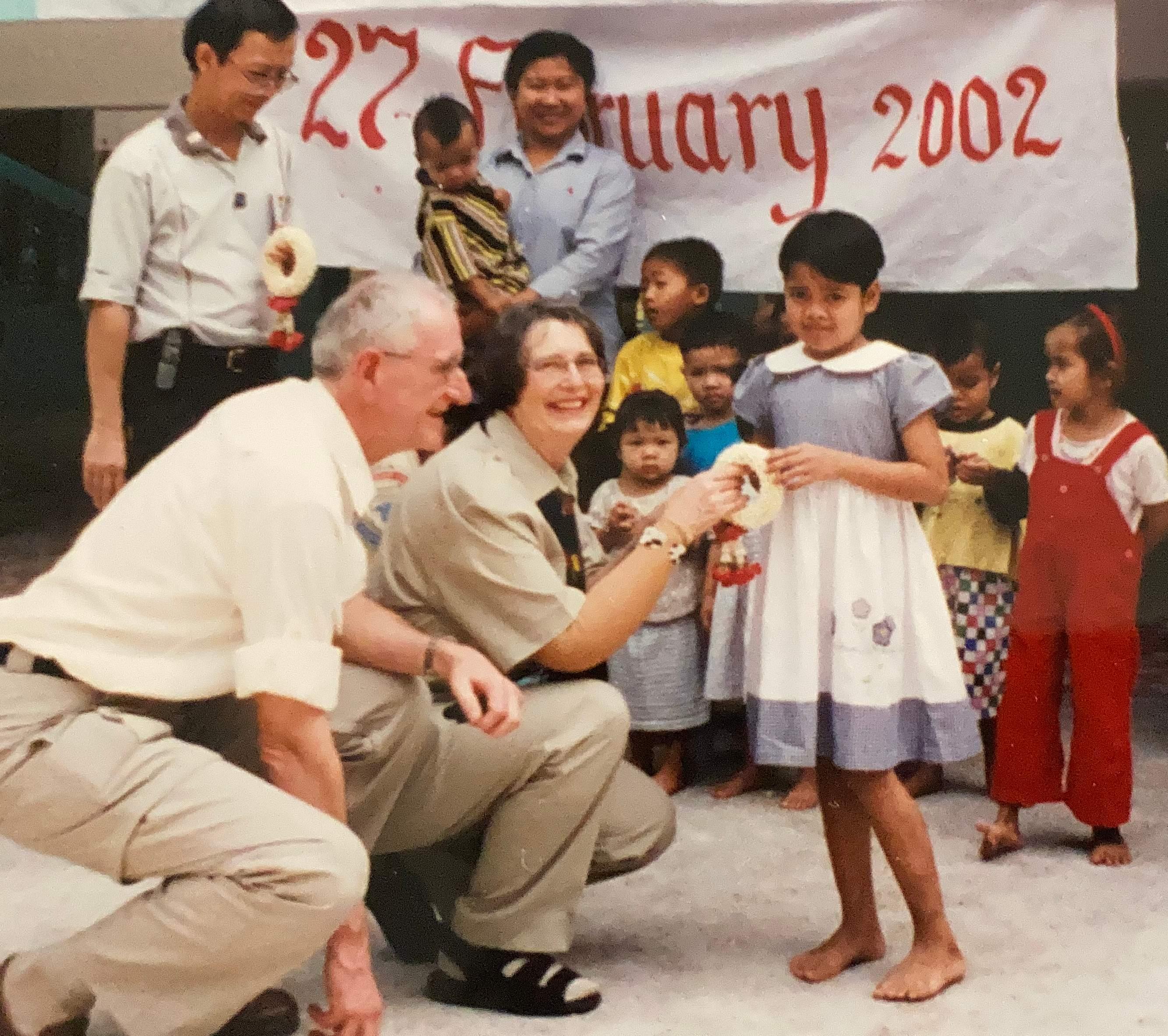 Walter and Ann Haessel with children in Thailand