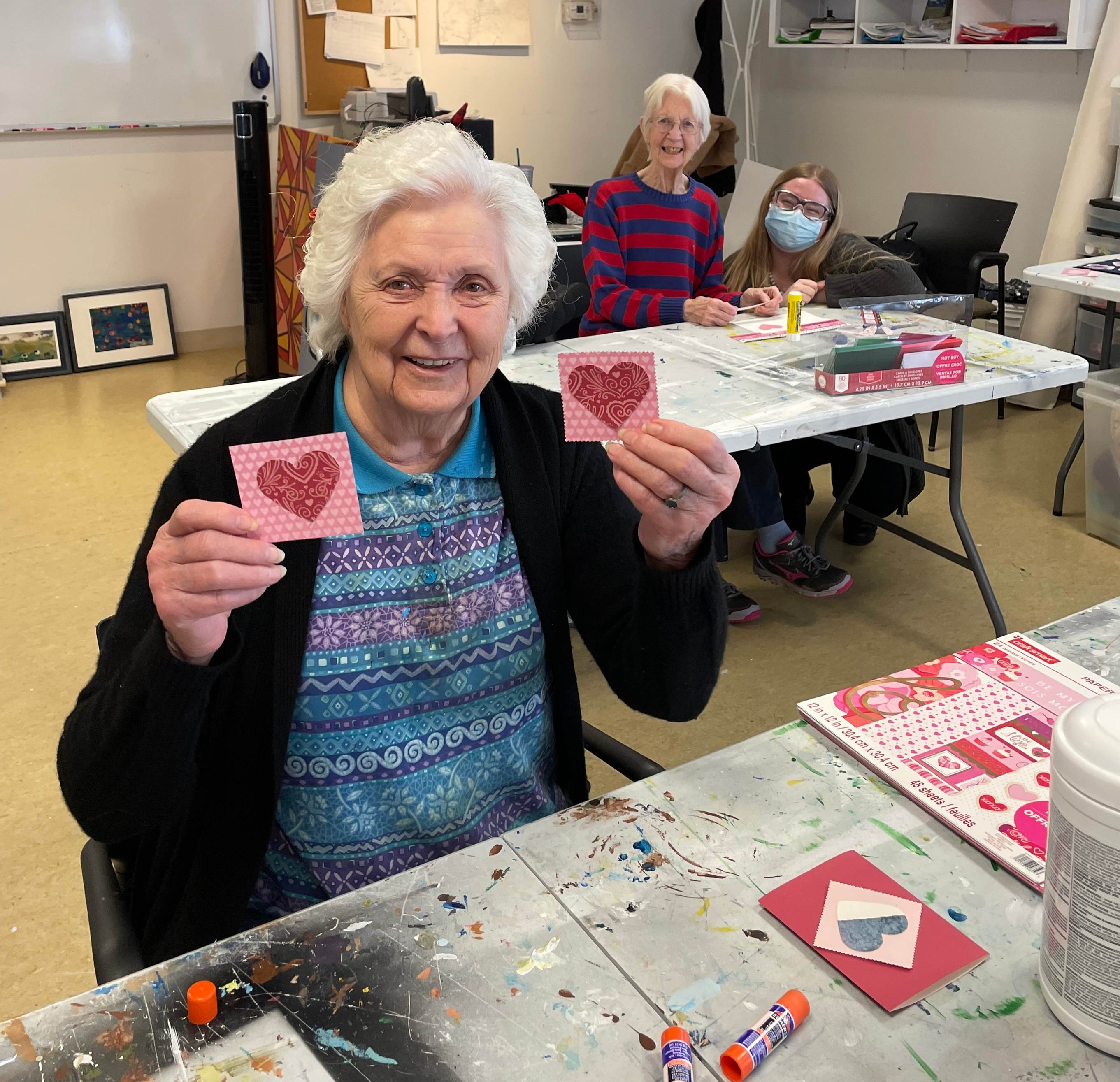 Fish Creek residents Irene Bell and Morag Sparrow put the finishing touches on their cards